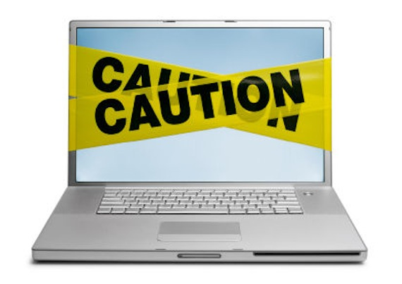 avoiding-internet-scams1-caution-laptop